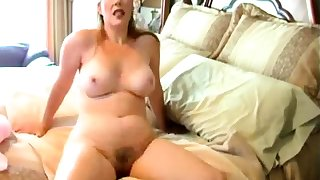 Beamy MILF With A Hairy Pussy