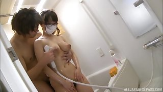 Hamaguchi Ena blows friend's penis before an tit fuck in the ladies' room